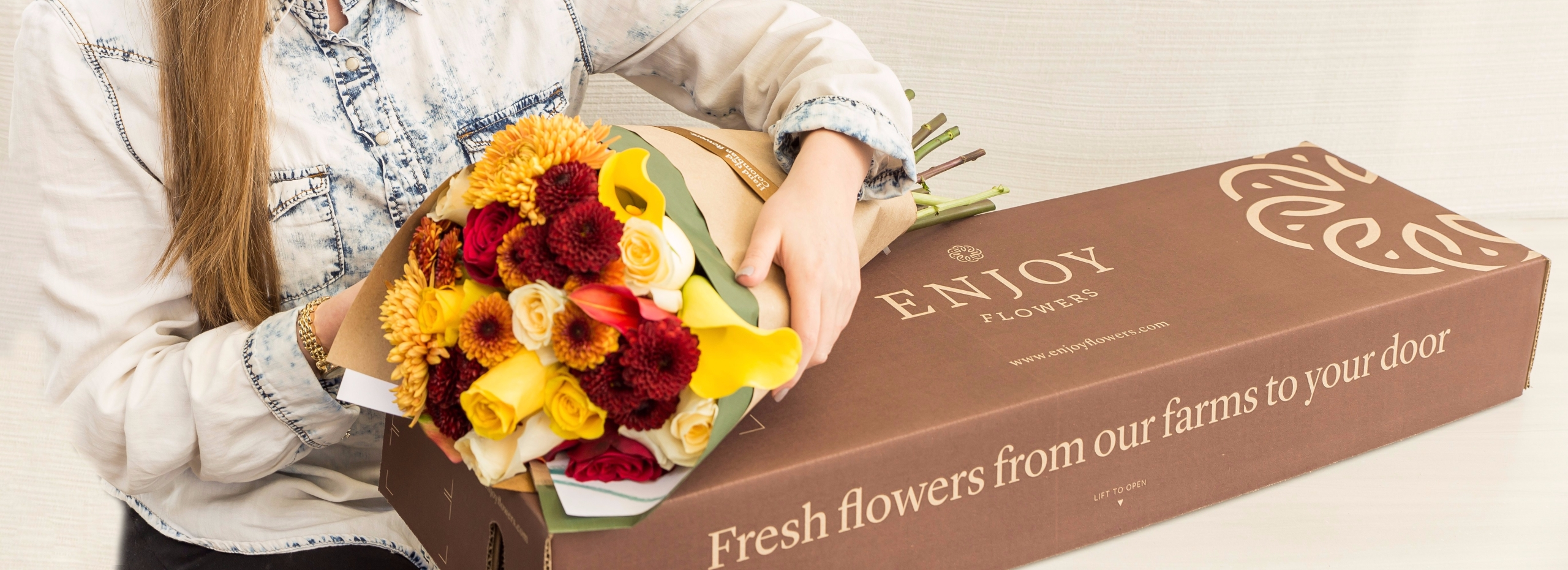 Customer with her flower subscription box